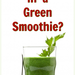Tall glass of a freshly blended green smoothie