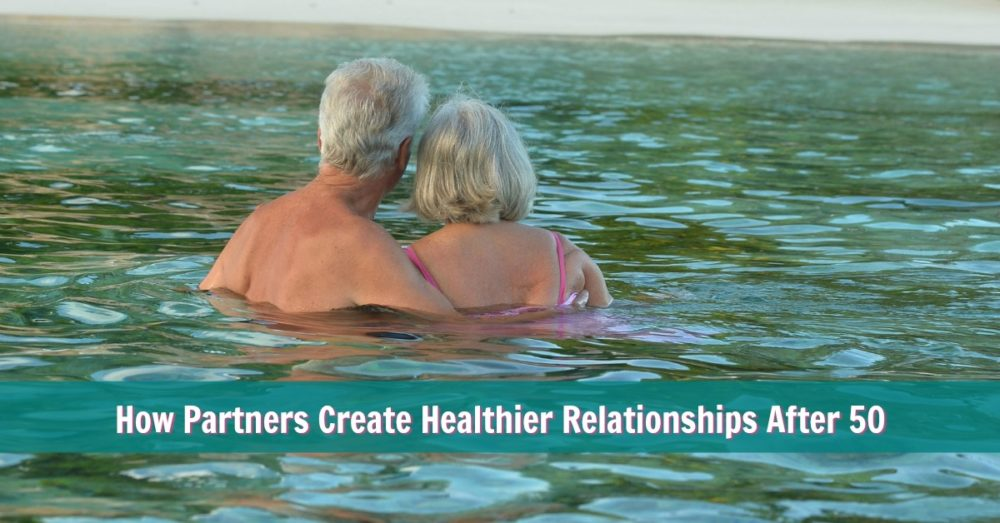 mature couple swimming affectionately at the beach