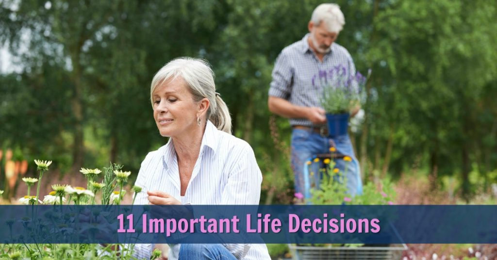 Happy, mature, fit couple gardening together outdoors.