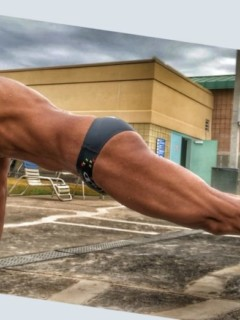 mature athlete doing push-ups by the pool