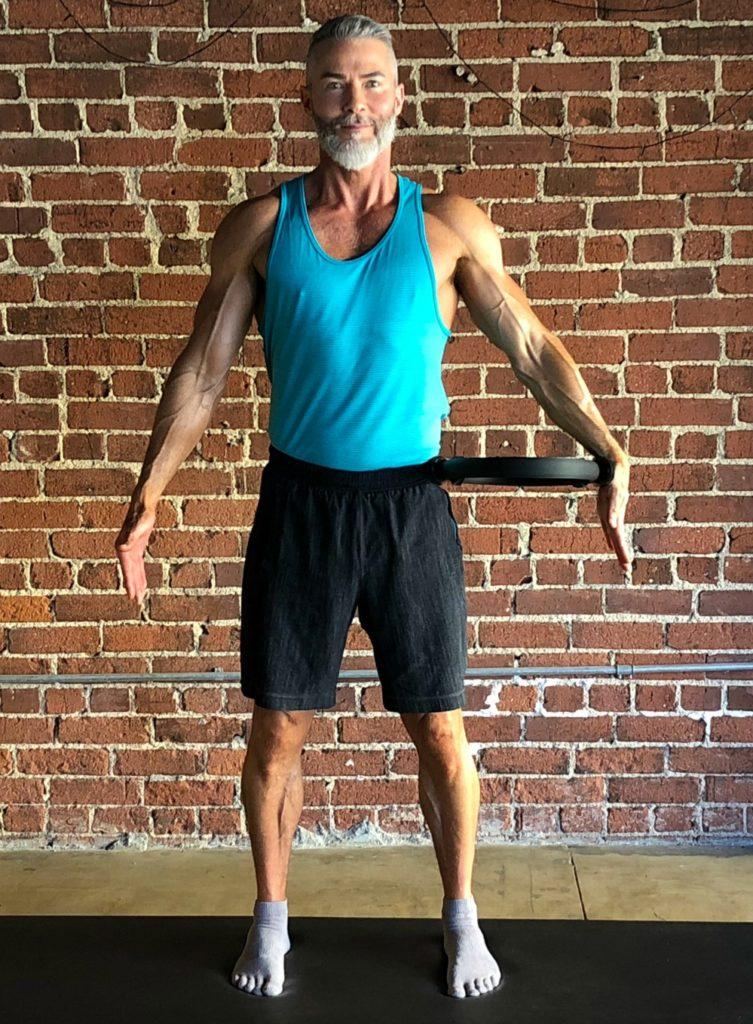 arm side on hip magic circle posture pilates