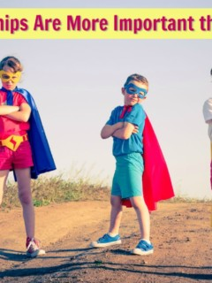 Three friendly children playing superheroes.
