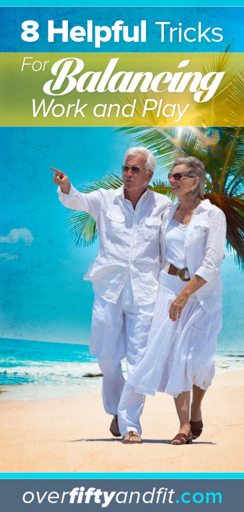 Mature, romantic couple walking on tropical beach.