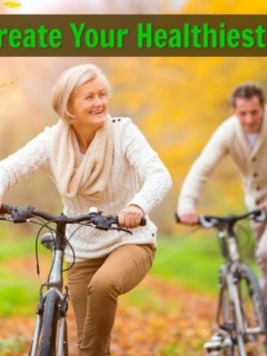 mature couple biking in park
