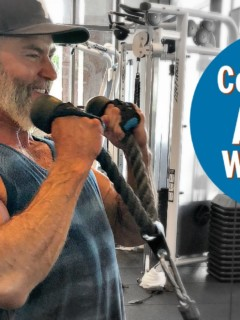 Man does cable bicep exercise