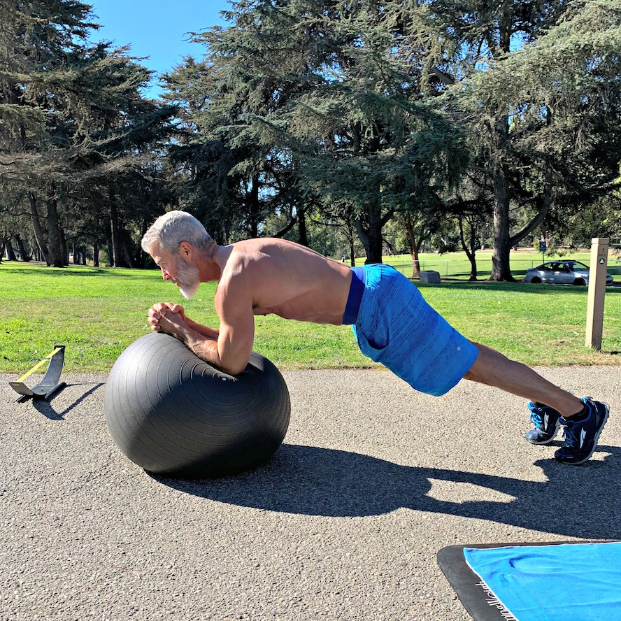 ball plank on elbows