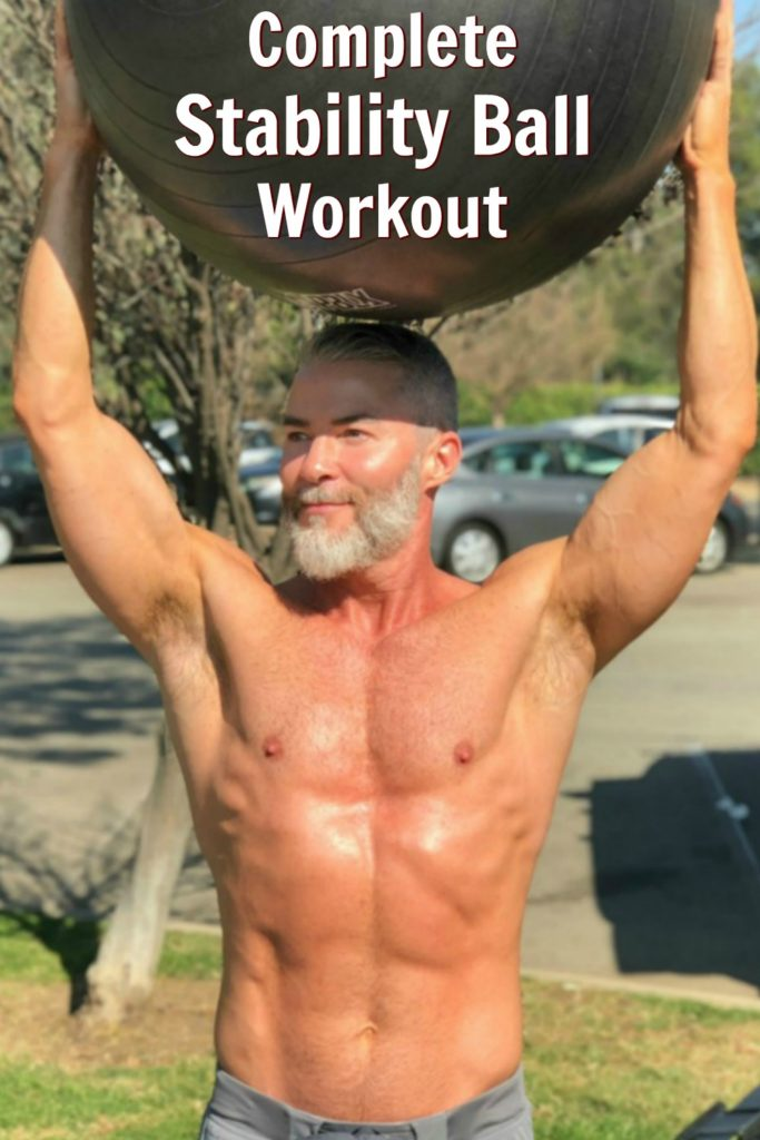 mature man working out with stability exercise ball