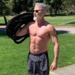 male athlete over 50 holding exercise battlerope