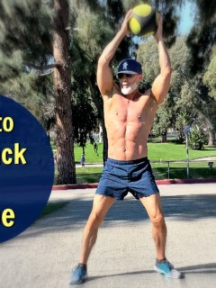 Fit, 53 year-old man exercising at park with balll.