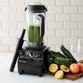 Vitamix blender full of green smoothie
