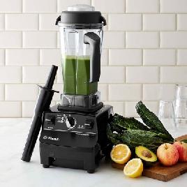 Vitamix blender full of green smoothie