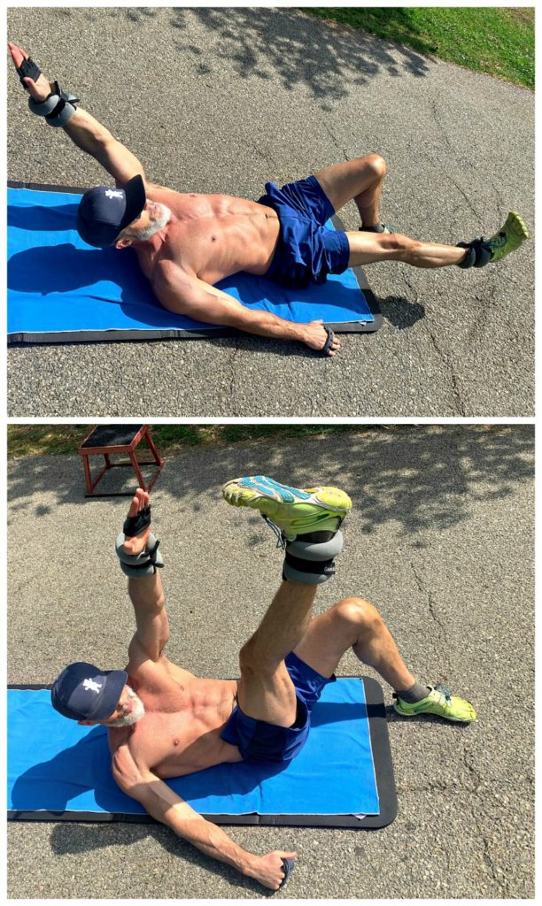 mature athlete doing abdominal alternating toe touches using ankle weights