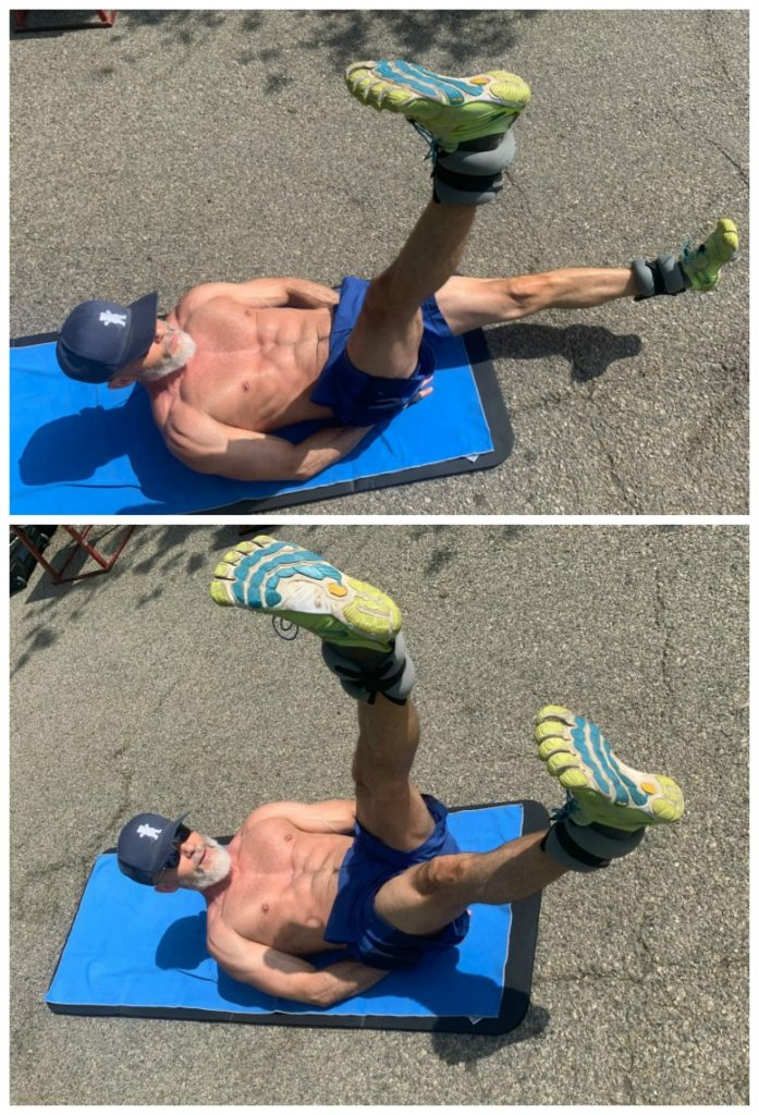 Older athlete doing ab workout with ankle weights.