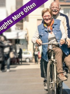 mature couple riding bike together in outdoor bazaar
