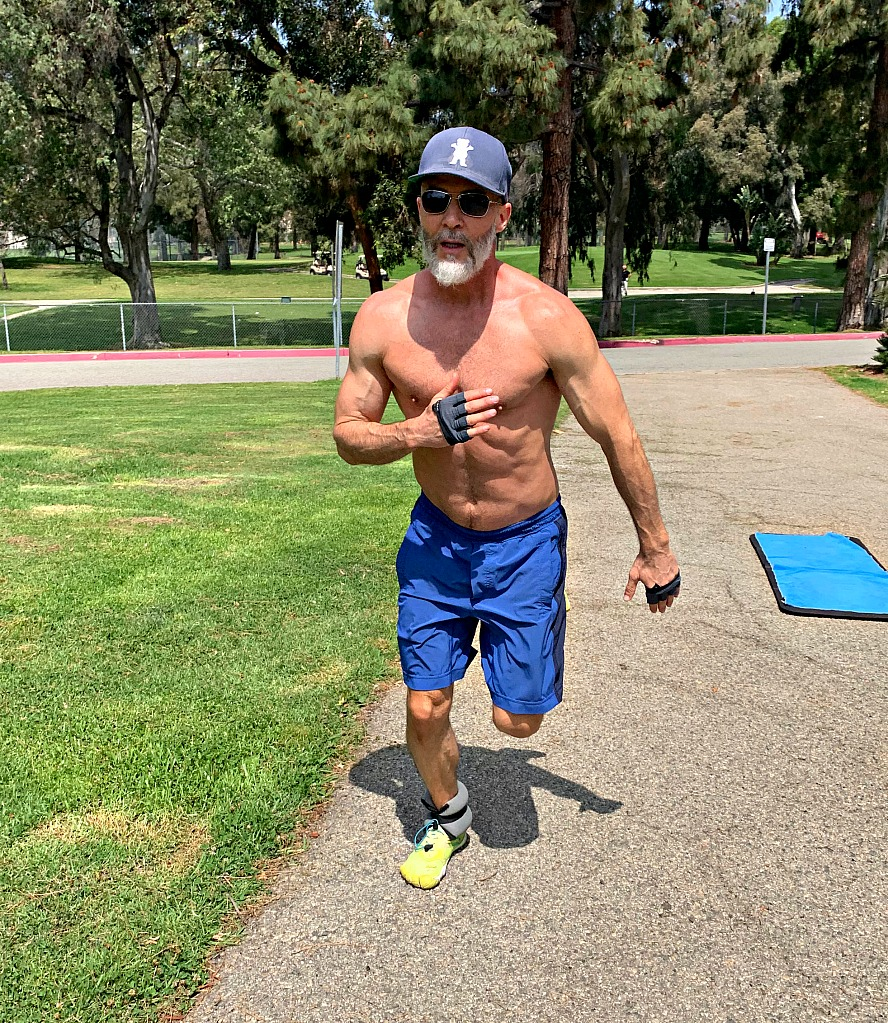 Man in park doing exercise drills in park.