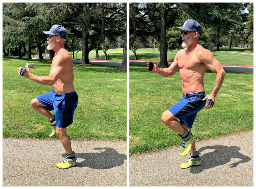 53 year-old athlete does high-knees exercise in park wearing ankle weights.