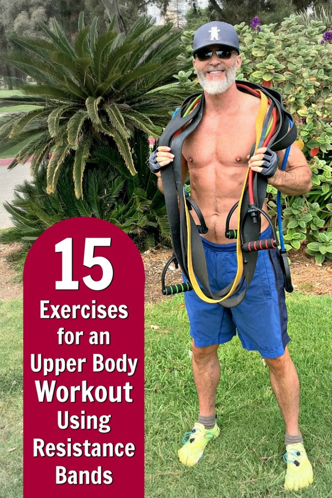 Fit, mature athlete holding many resistance bands in preparation for an outdoor workout.