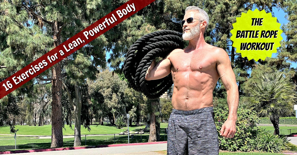 A fit, 53 year-old athlete training outdoors with battle rope.