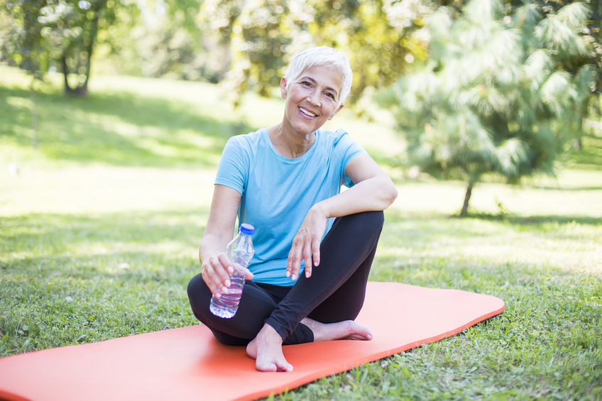 fit woman over 50 exercising outdoors