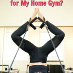 Woman doing Pilates on her reformer at home.
