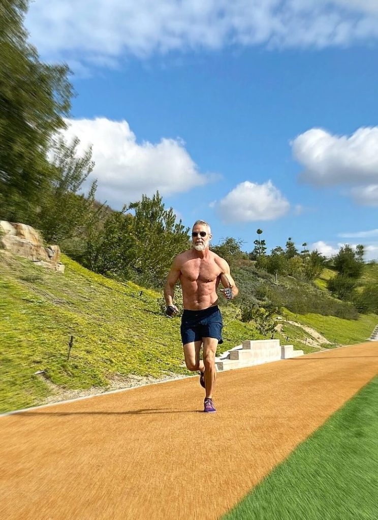 mature man running outdoors for Leg Day training.