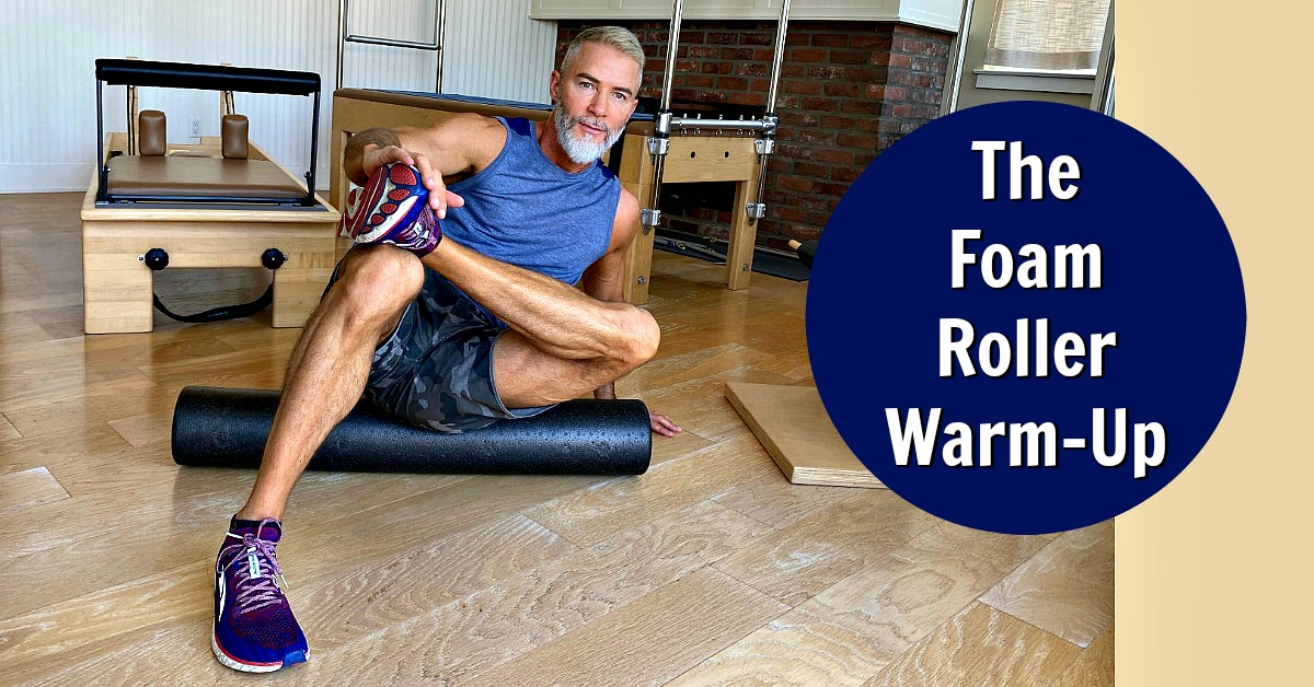 Mature athlete foam rolling before workout.