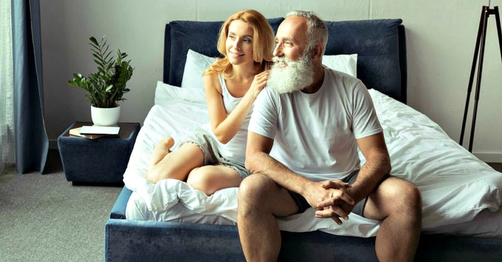 Mature couple relaxing together at home, avoiding common health mistakes.