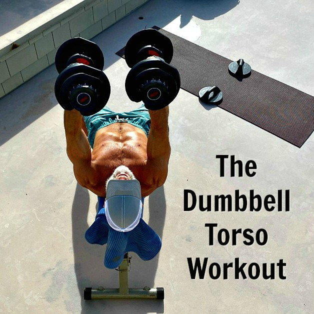 54-year old athlete trains with dumbbells during a rooftop workout.