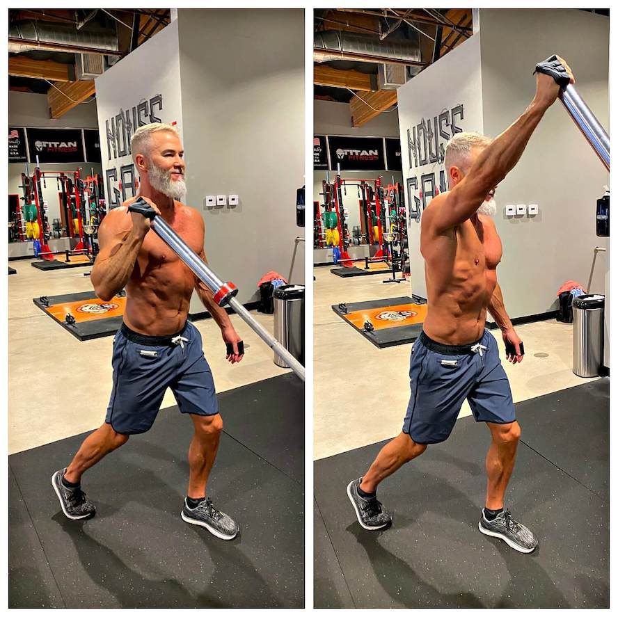 Dane Findley, age 54, demonstrates a shoulder press with a leaning barbell.