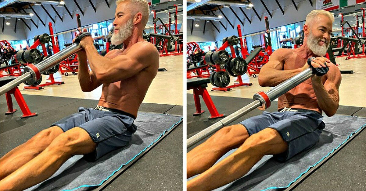 Athlete strengthens ab using landmine barbell.
