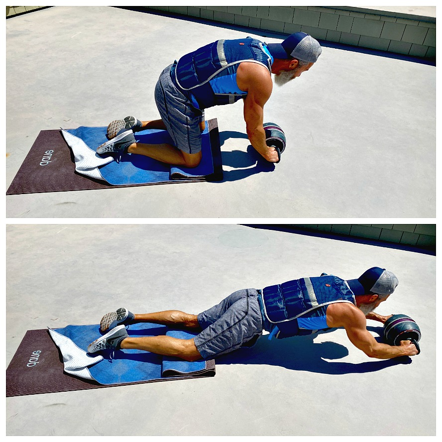 Athlete, age 54, does ab roller exercise in weighted vest.
