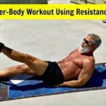 Mature athlete trains lower-body muscles using a resistance band.