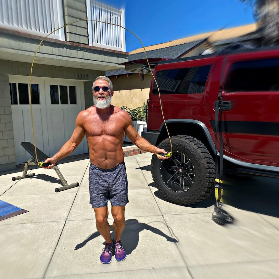 Older athlete does high intensity interval training in his driveway.