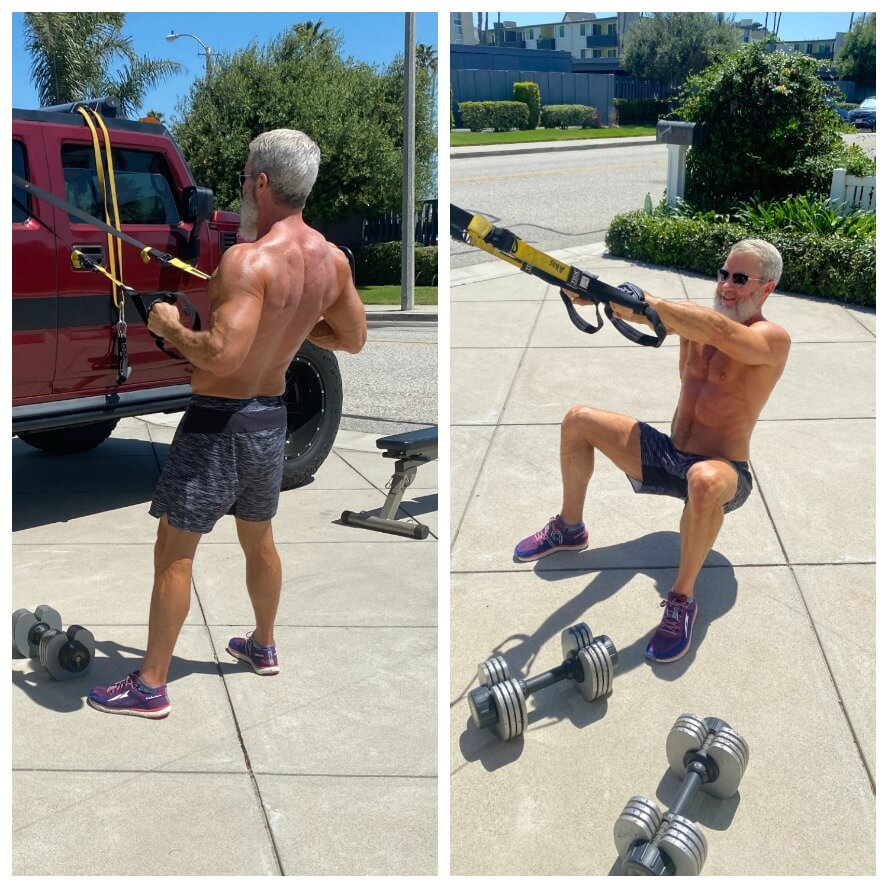 Muscled man does driveway fitness training.