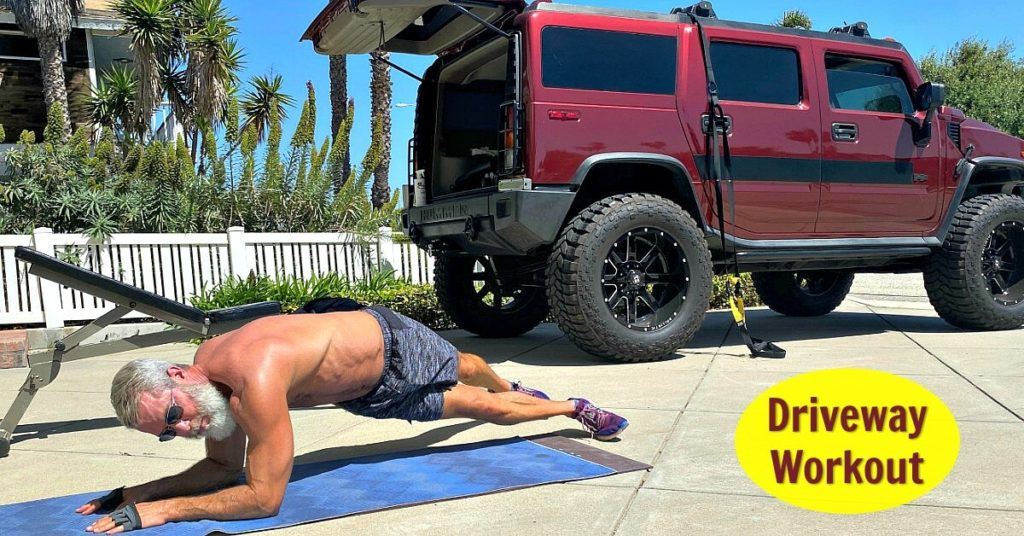 Mature athlete fitness training in his driveway.