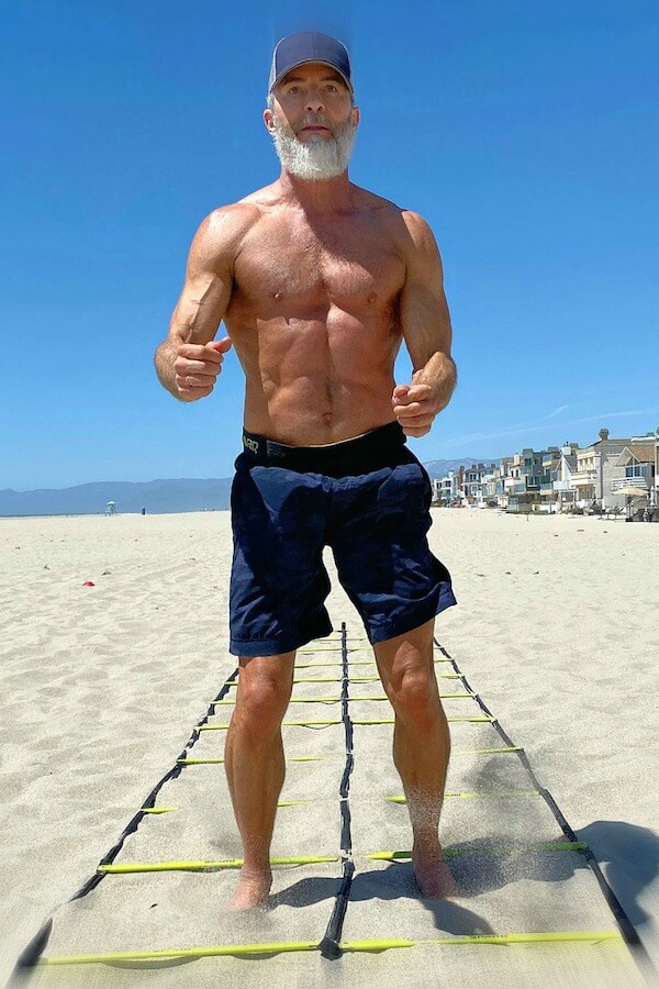 Dane Findley does speed ladder drills at beach, barefoot in the sand.