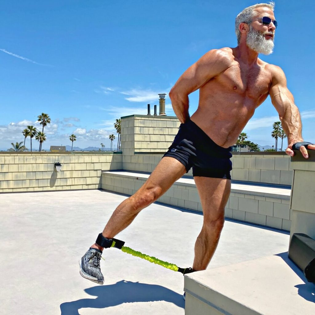 Dane Findley, age 54, does leg-sculpting exercises for the glute muscles.