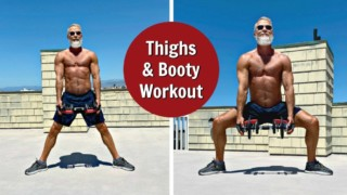 Older man does sumo squat exercise with dumbbells for leg muscles.