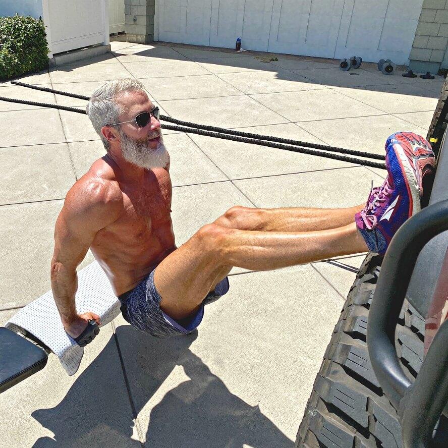 man exercising in his driveway