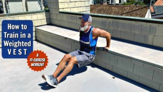 Older male athlete working out in a weighted fitness vest.