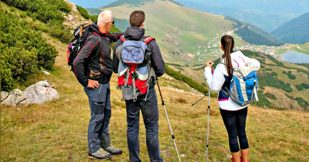 Three hikers forming multigenerational collaborations.