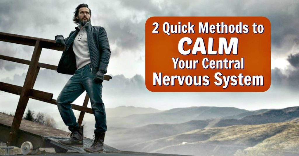 Strong man outdoors, using methods to calm nervous system.