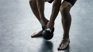 beginner-level athlete using kettlebell