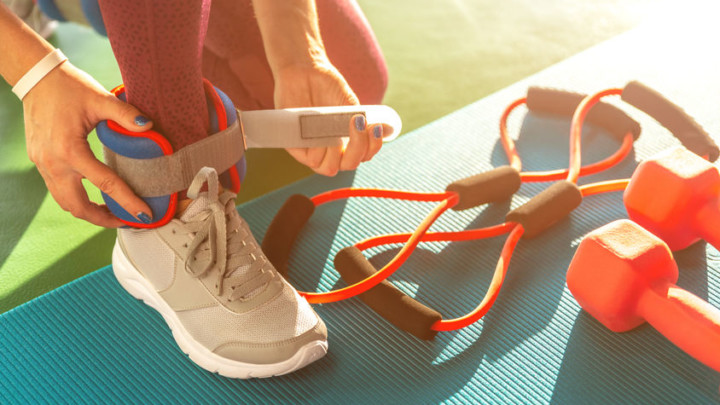 woman working out weight ankle weights