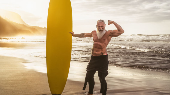 mature surfer looking confident