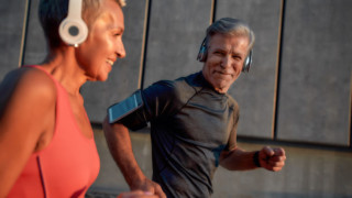 mature couple exercising happily