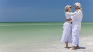 couple at beach being healthy after 60