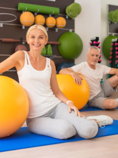 fit mature couple doing mat exercises