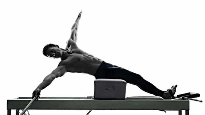 fit man on pilates reformer