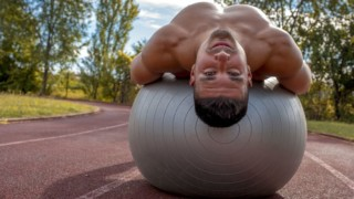 fit man exercises on stability ball